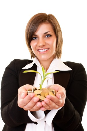 young businesswoman holding a growing plant and coins photo