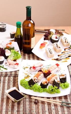 nicely: portion of nicely arranged sushi rolls on table with brown mat