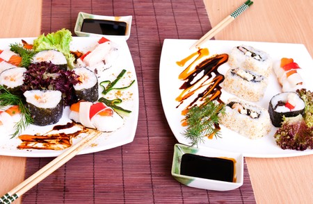 table set for two – delicious sushi on menu  photo