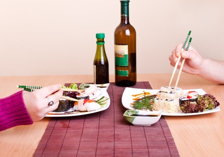 table set for two – delicious sushi on menu with beverage Stock Photo - 7539976