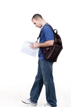 young male student walking to school and studying photo