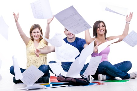throw up: happy students throwing books away – end of school Stock Photo