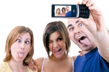 funny photo of three young people making silly faces photo