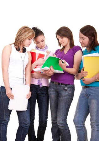 adolescence: group of young teenagers studying on white