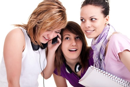 curiously: group of girls listening to cellphone curiously