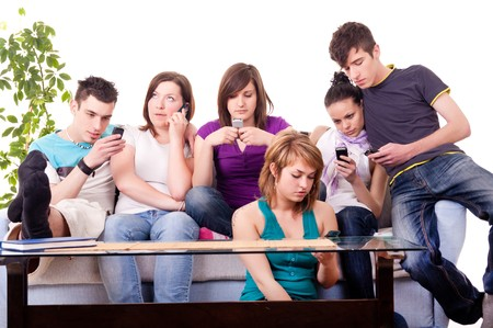 mania: group of teenage kids with cellphones – mobile mania Stock Photo