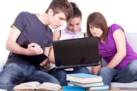 three young student studying and working on laptops photo