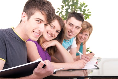 studygroup: portrait of a young male student studying with his classmates Stock Photo