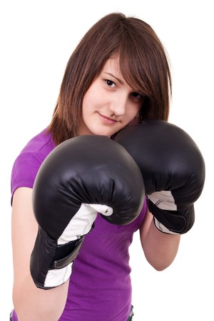 young woman with boxing gloves threatening on white photo