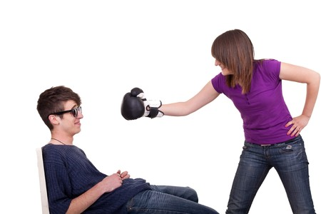 young woman threats to his boytfriend with boxing gloves photo