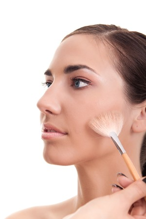 close-up of a woman applying make-up isolated on white Stock Photo - 7807620