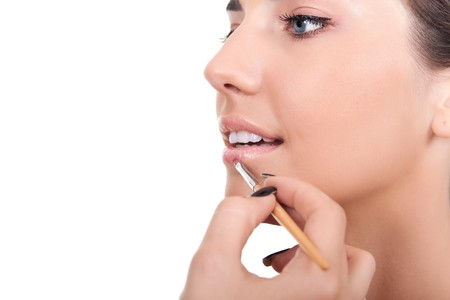 closeup of a woman applying lip gloss with brush Stock Photo - 7807610