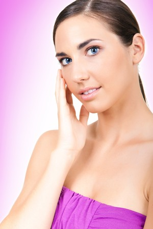beauty with natural pure skin on pink background photo