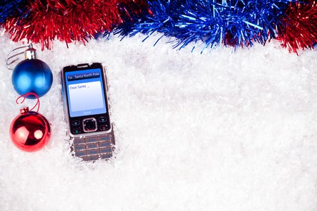 mobile phone with message to Santa and decoration photo