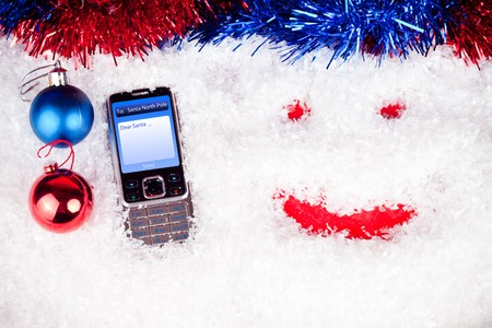 mobile with message to Santa ,christmas balls  and smile in snow  photo