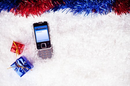 mobile with message for Santa with xmas decoration photo