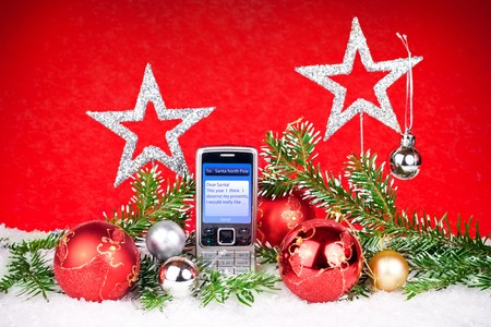 christmas decoration and mobile phone with message to santa photo