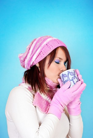 beautiful young woman is cold and she is drinking her tea photo