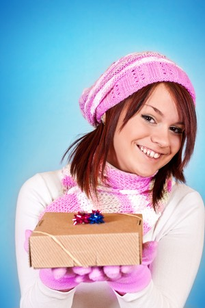 cute girl giving a gift to you, on blue background photo