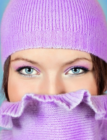 close-up of eyes of a beautiful girl with scarf and hat photo