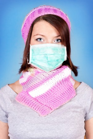 beutiful girl with protection mask  on blue background photo