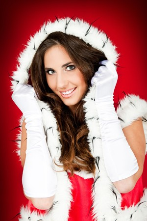 beautiful woman wearing santa claus clothes photo