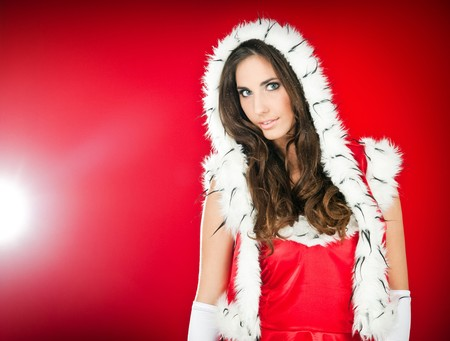 beautiful woman wearing santa claus clothes Stock Photo - 8095779