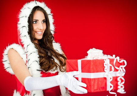 beautiful santa woman with present – side view photo