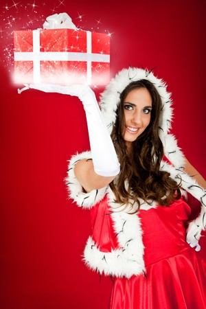 beautiful santas helper holding sparkly Christmas present photo