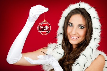 happy woman in santa clothes holding Christmas decoration photo