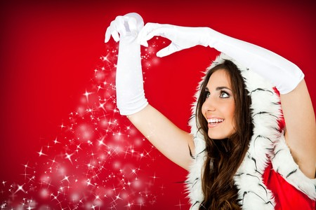 santa woman watching the snowflakes fall from her hands Stock Photo - 8095767