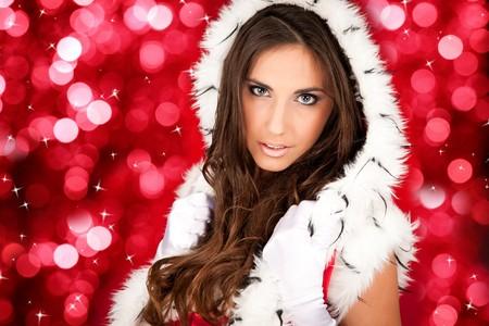 portrait of a sexy santa woman on shiny background Stock Photo - 8095784