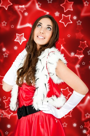 sexy girl in santa costume on abstract background photo