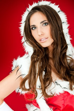 portrait of a beautiful sexy santa woman on red  photo