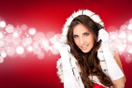 sexy girl in santa costume on abstract shiny  background photo
