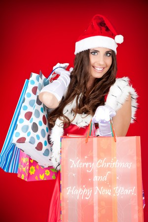 sexy santa woman holding colorful shopping bags Stock Photo - 8095771