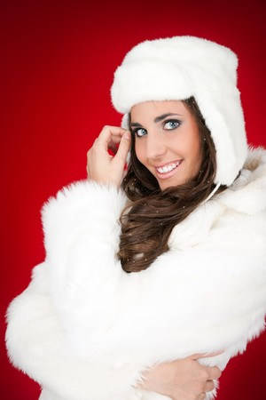 attractive young woman in white furry cloth posing photo