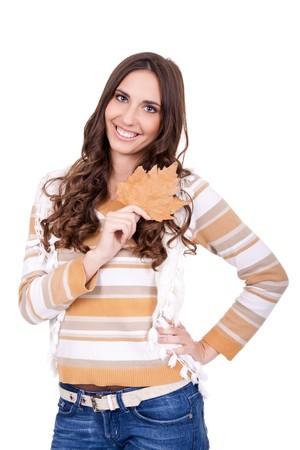 beautiful autumn woman holding leaf on white background photo