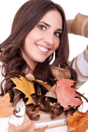 closeup of a beautiful autumn woman with leaves photo