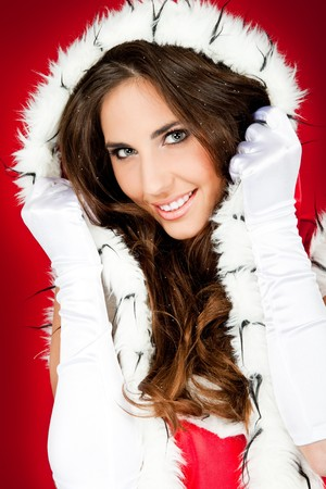 close-up of beautiful woman wearing santa claus clothes photo