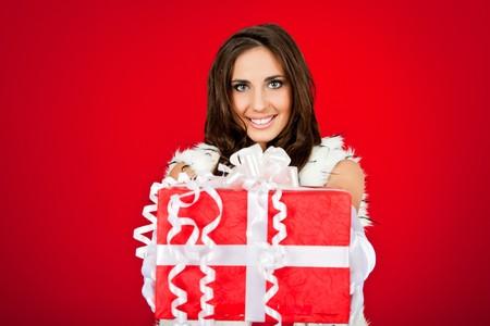 beautiful woman holding big Christmas present photo