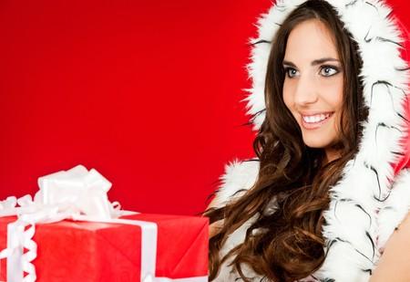 closeup of a beautiful woman holding xmas present photo