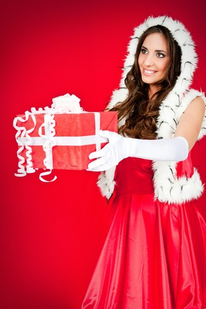 beautiful  woman in santa costume with present side view Stock Photo - 8095822