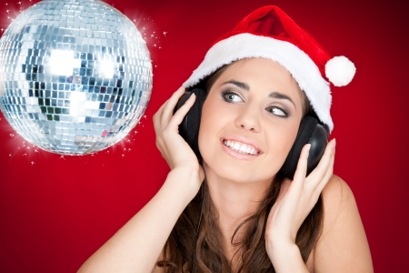 Christmas girl with disco ball listening music photo