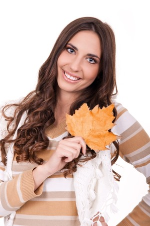 smiling girl holding an autumn leaf isolated on white photo