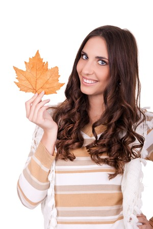 young attractive autumn woman holding leaf photo