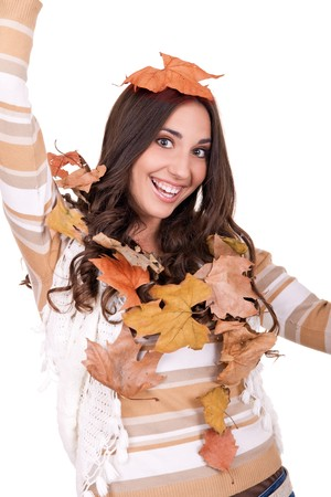 beautiful happy woman with a pile of autmn leaves Stock Photo - 8095820