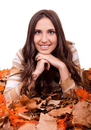 beautiful autumn woman covered with mapple leaves photo