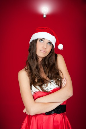 beautiful brunette santa woman with an idea photo