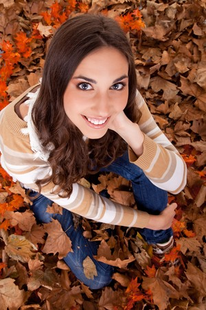 beautiful autumn woman posing – view from above photo